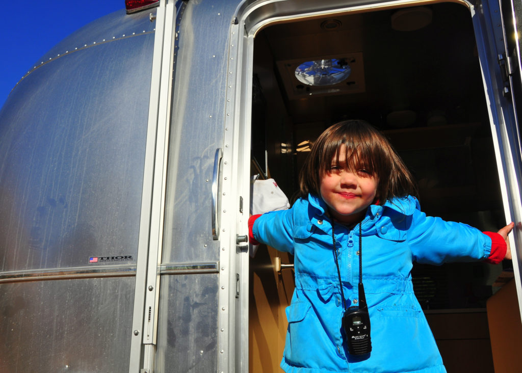 Small child with and FRS radio and an airstream trailer