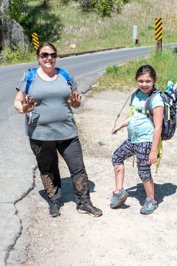 Mom and daughter posing in muddy clothes after a hike to Grotto Falls near payson lakes